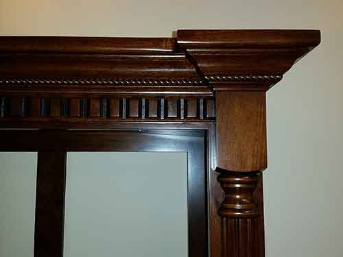 Custom rope molding on gun cabinet