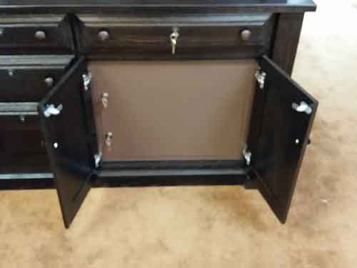 Steel safe doors on a custom Amish crafted guncabinet