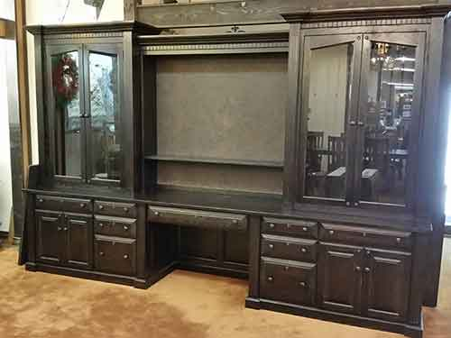 Gun cabinet with tv display in center