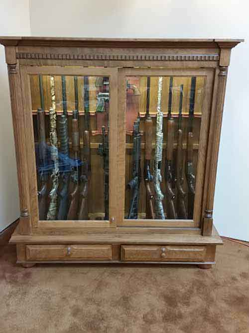 Amish custom made gun cabinet with shallow based drawer storage