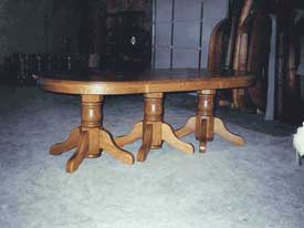 Triple Pedestal Oval Table with 10 Leaves
